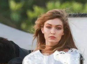 13ba214582b86b Gigi Hadid flashes underboob in metallic crop top for beach photoshoot ...