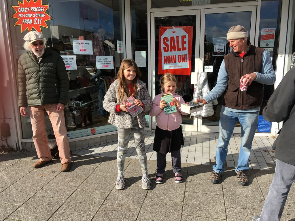 Hundreds form human chain to move their local bookstore