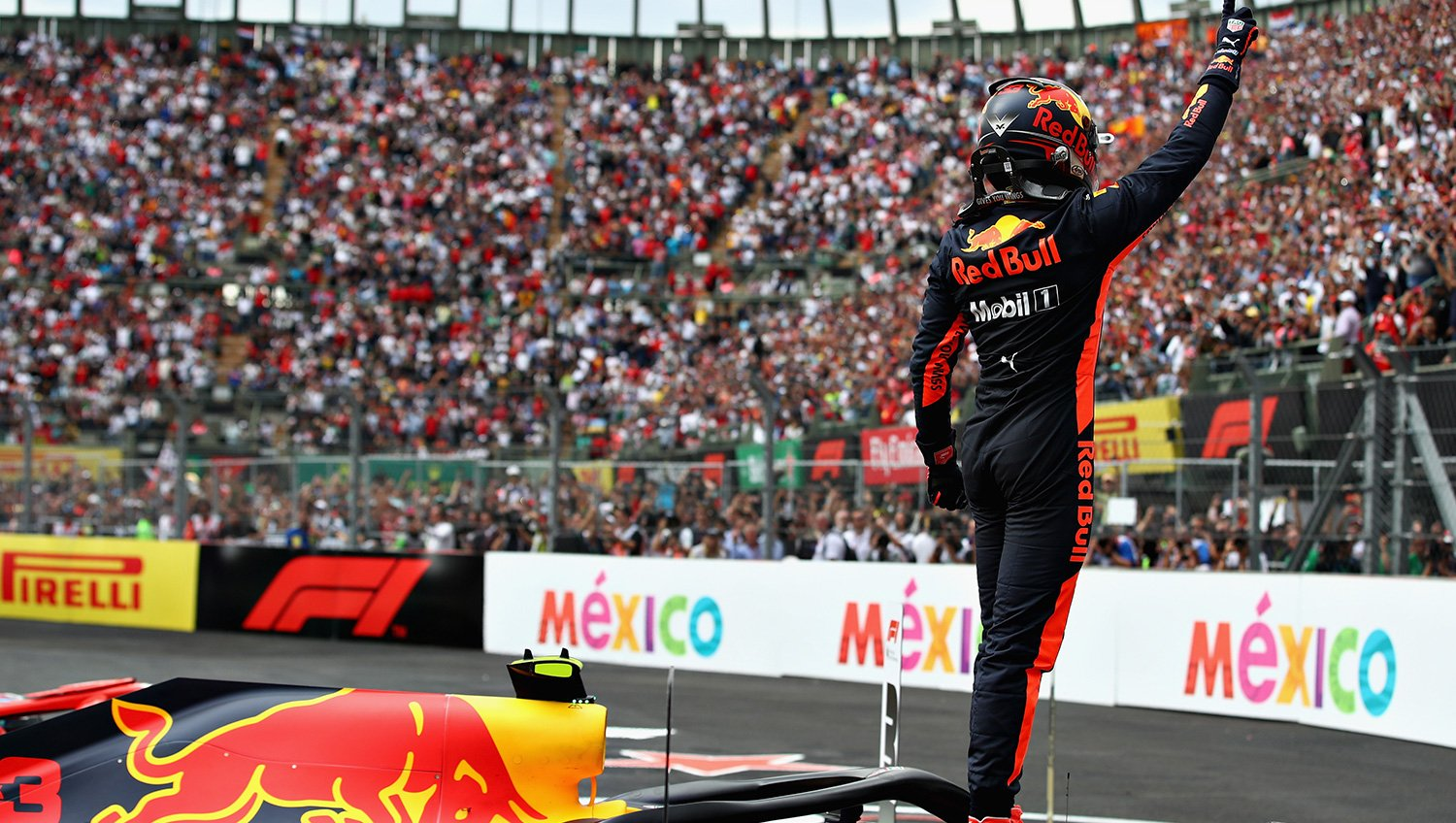 Max Verstappen celebrates with the crowd after winning the Mexican Grand Prix!