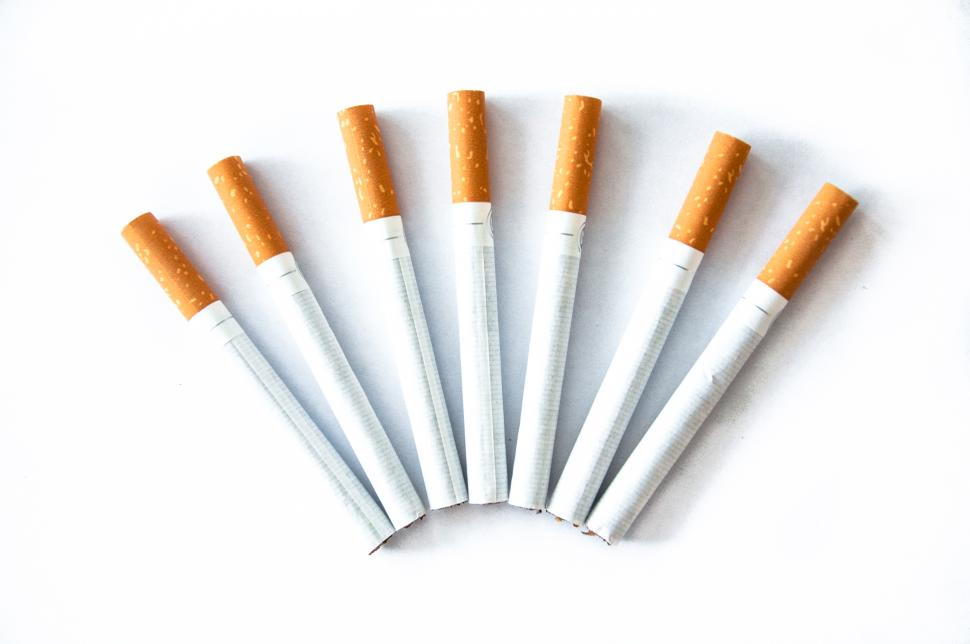 seven cigarettes displayed in an arc shape