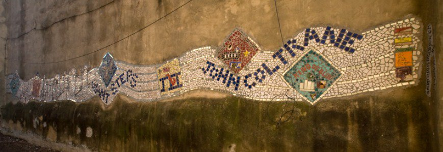 """John Coltrane composed """"Giant Steps"""" when he was living in #StrawberryMansion neighborhood in North Philadelphia. A mosaic commemorating the milestone is on a wall in an alley two doors from where the #jazz legend lived.  #PublicArt #CulturalHeritage #PhillyJazzLegacy"""
