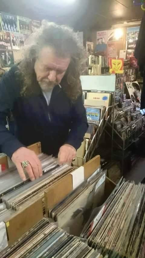 You might be cool. But you'll never be as cool as Robert Plant digging through vinyl.