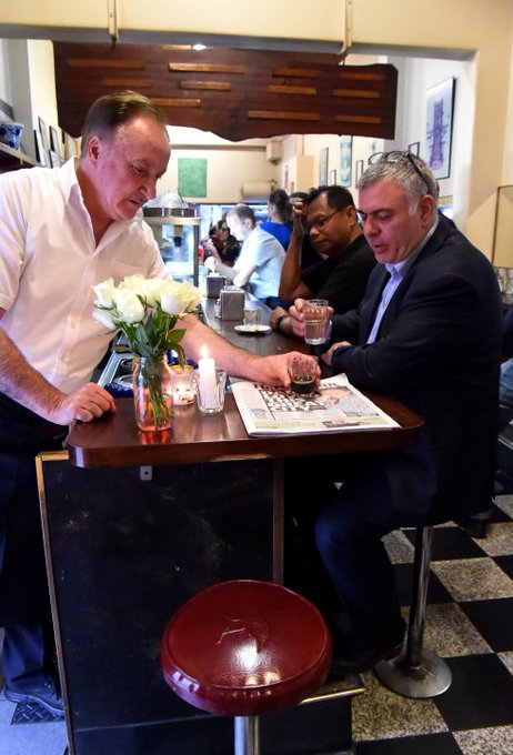 The Melbourne café run by Sisto Malaspina, the victim of last week's Bourke Street terror attack, reopened this morning. The seat where the co-owner would read the paper was left empty with his favourite coffee - a long black. #9News Photo