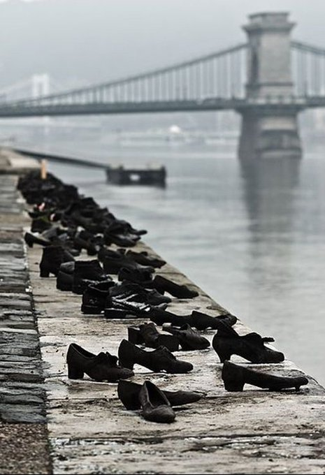 'Shoes On The Danube Promenade' Can Togay & Gyula Pauer [WW II Budapest: Jews were brought to the edge of the Danube, ordered to remove their shoes;they were shot, falling into the water; 60 pairs of iron shoes now line the river's bank as a memorial] #LestWeForget Photo