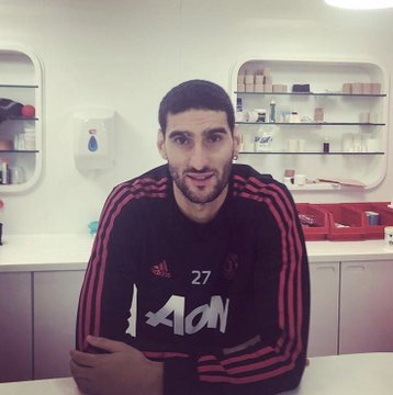 Footballer, Marouane Fellaini cuts off his trademark curly afro (Photo)