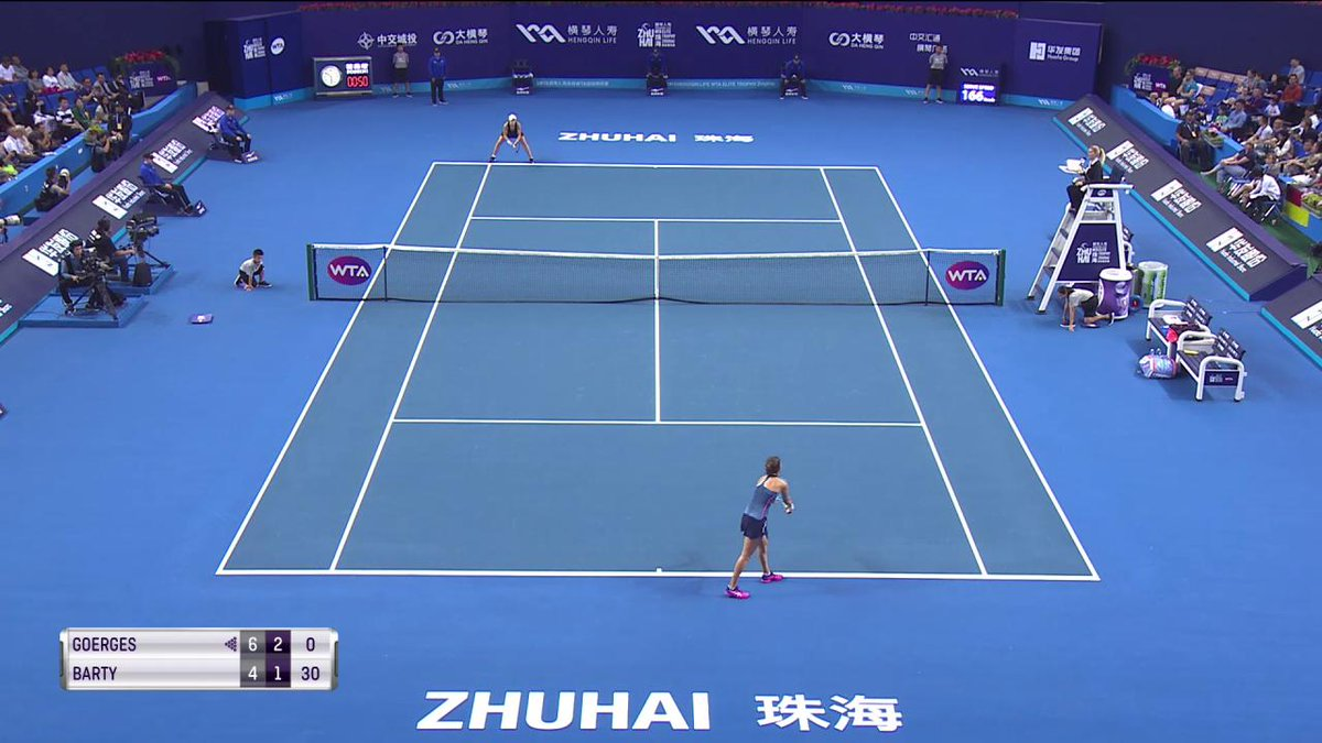 .@ashbar96 takes the point of the match with this roaring backhand! #WTAEliteTrophy