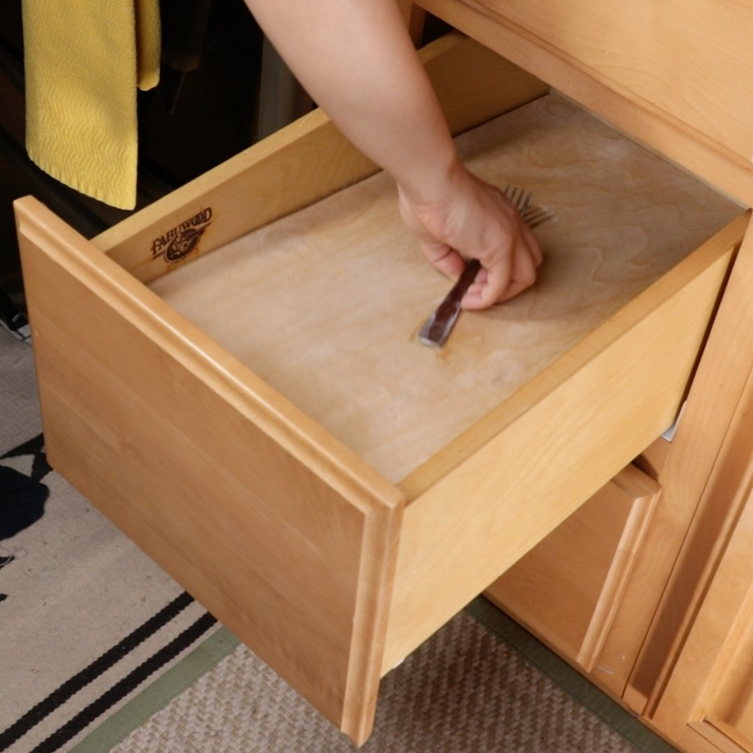 Hide your sneaky stash with this false bottom drawer!