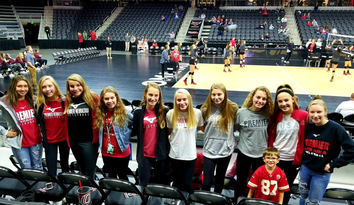 Team bonding! @Premier_VB 14 Red cheering on their coaches at the @OmahaVB game! #premierproud #extralittlefaninthefront
