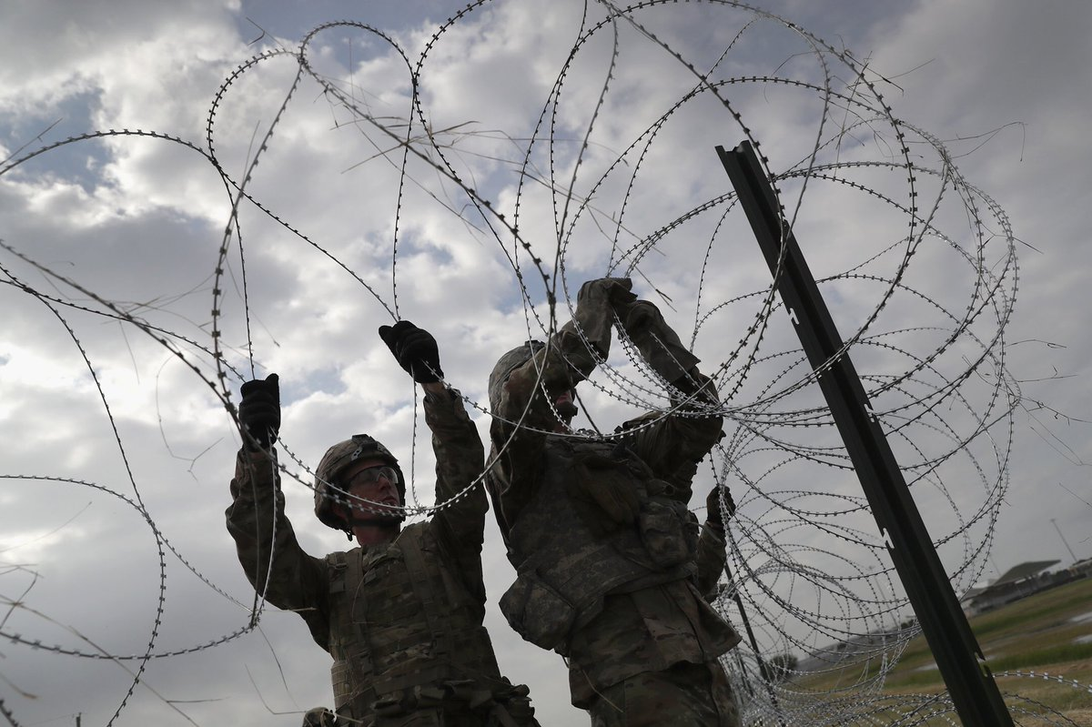 """The Razor wiring of key ports of entry between the US and Mexico continues. Soldiers sometimes measure their deployments by time spent """"in country."""" This time they're in their country. Operation Faithful Patriot. #gettyimages #army #gettyimagesnews #border #immigration"""