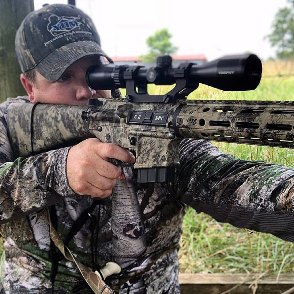 Heath Wood of @furandfangsmag on the hunt for predators with the YHM Hunt Ready rifle! Rifle comes  ready to go right out of the box - all you need is the ammo. • • • #yhm #yankeehillmahine #yankeehill #hunt #huntready #kryptek #68spc #predator #pewpew #pewpewpew #2a #hunting