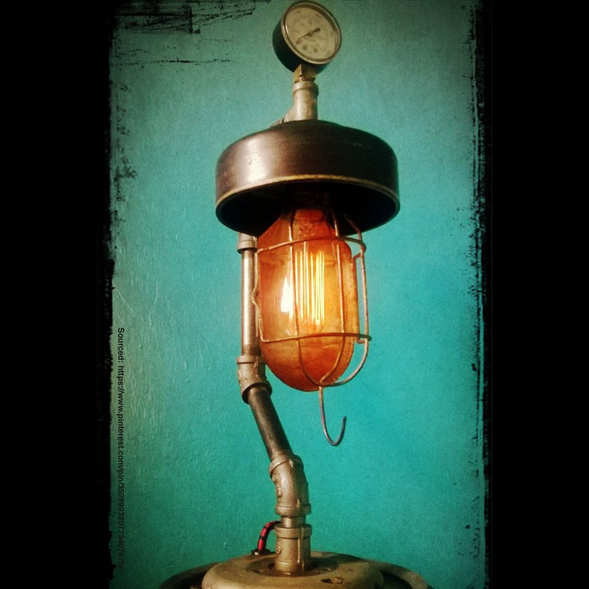 Industrial lamp made with recycled car lamps! Really steampunk looking. #RecycledCarParts #CarPartsArt #Lamp #Sculpture #Art #CarParts #AutoParts #RecycledMaterials #Recycle #RecycleAutoParts