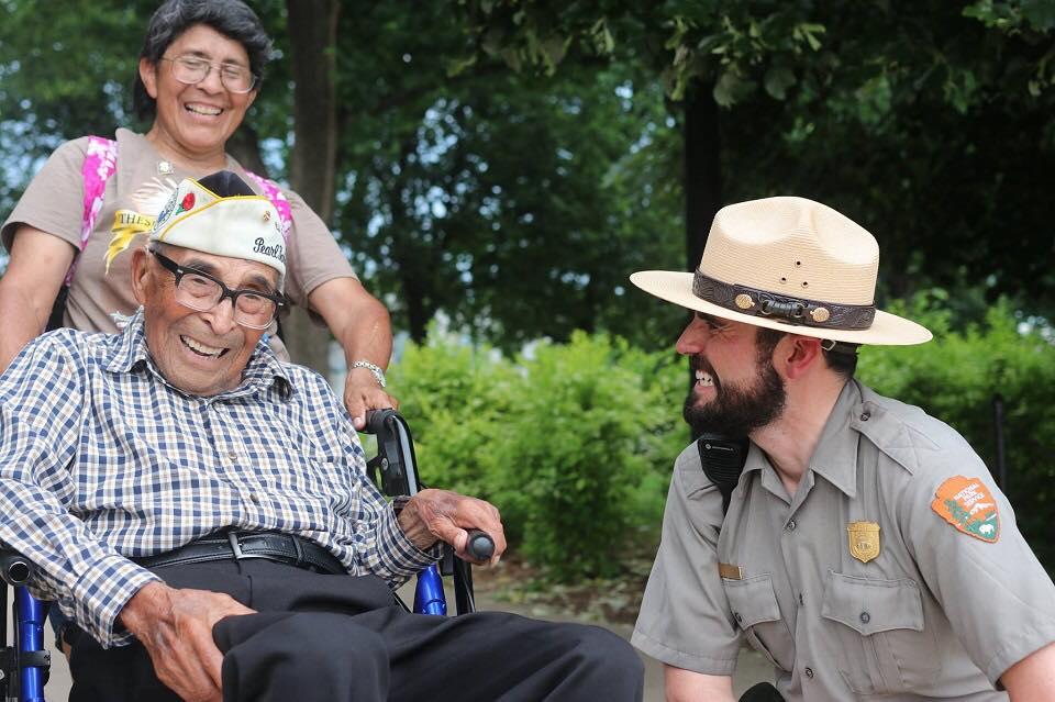 Park ranger greets veteran near the World War II Memorial in Washington, DC