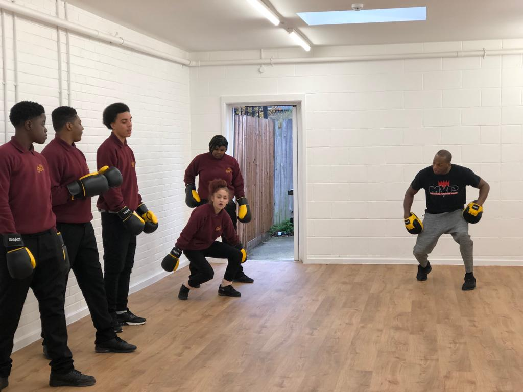 Students enjoying another mixed Martial Arts session with Michael Page