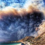 """Billy Griffin THE """"LAKE MALIBU"""" FIRE TODAY... The fire started in the Thousand Oaks/Oak Park area and traveled South-East thru Malibu Canyon and the Pacific Ocean. This is a photo of the PCH Highway and the Pacific Ocean. — at Pacific Coast Highway."""