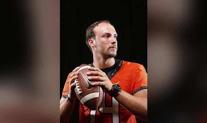 The quarterback for Oklahoma State looks like he has 2 kids and a mortgage Photo