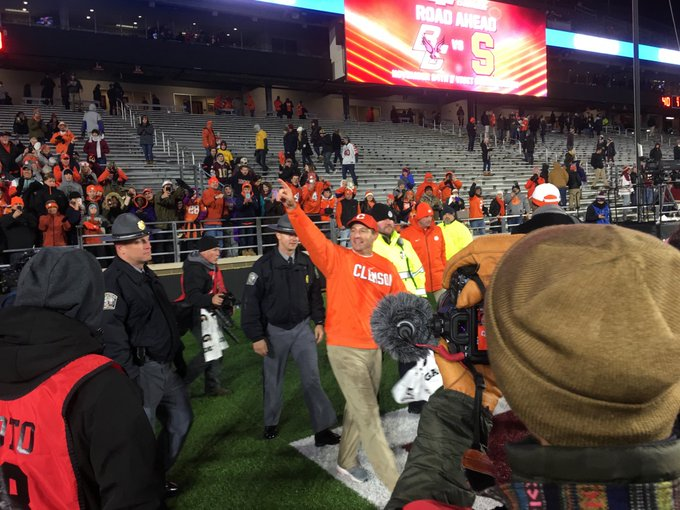 A coach who wins all the time waves to fans who don't mind winning all the time #CLEMvsBC Photo
