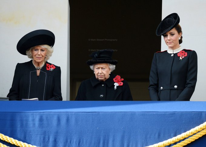 HM The Queen is joined by the next two King of Englands consorts The Duchess of Cornwall and Duchess of Cambridge as she watches The Prince of Wales place her wreath at the Cenotaph on the 100th Anv of the end of WW1. Photo