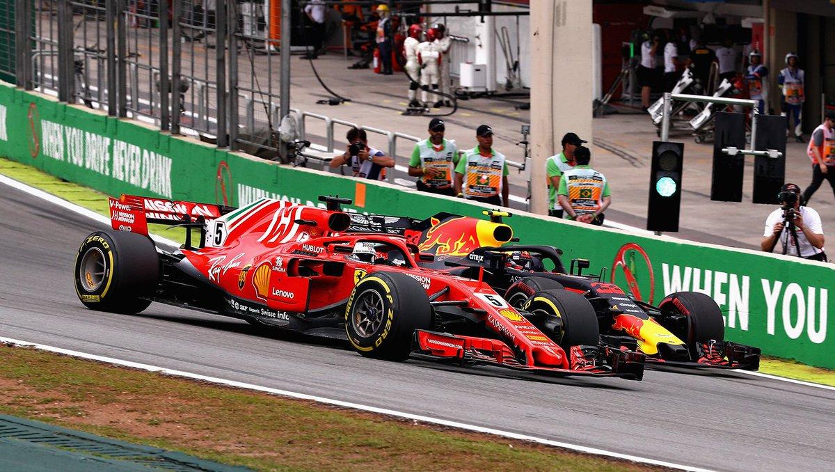Max overtakes Vettel on the inside.