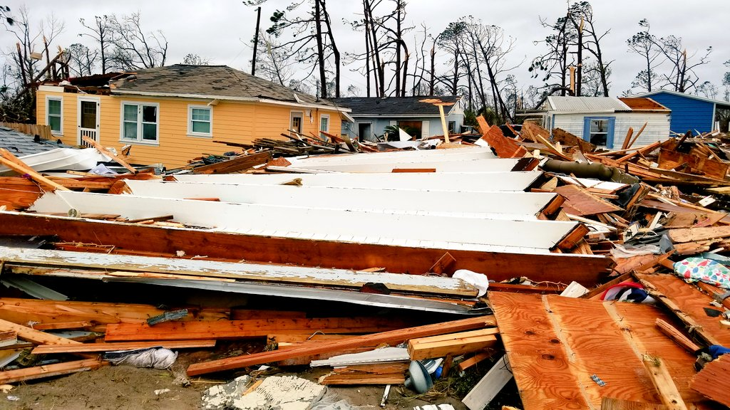 #weatherpicofday homes (not in original locations) &amp; debris piled-up following Hurricane Michael CAT 5 storm surge (18-21 ft) in Mexico Beach FL 10 October 2018 w/ @JustonStrmRider<br>http://pic.twitter.com/IWurOSE0Ps