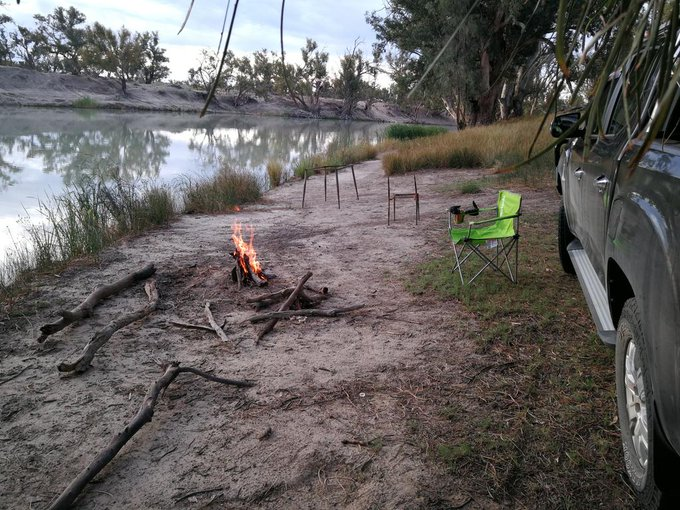 Fire lit. swag laid. Before sunsets pooncarie road out of Wentworth Darling River Foto