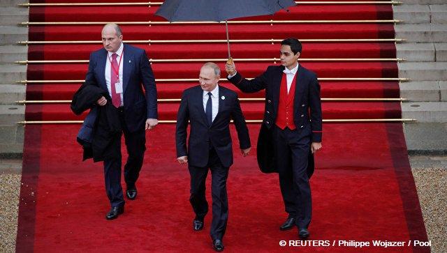 В Кремле рассказали о разговоре Путина и Трампа в Париже Фото