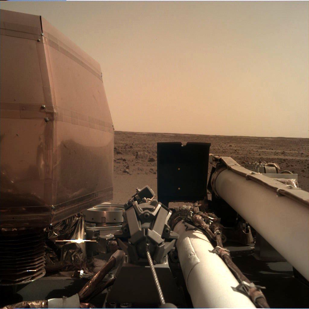 Image of Mars with lander arm and instrument visible