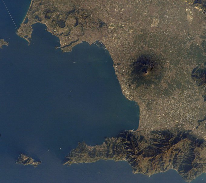A new study in Science Advances shows that the Campi Flegrei caldera in Italy, one of the most dangerous volcanoes on Earth, might be warming up. However, a big eruption is likely still a long way off (Image: NASA): Photo