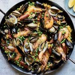 Image for the Tweet beginning: This seafood-lover's version of paella