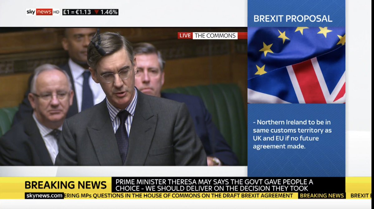 "Jacob Rees Mogg asks PM why he shouldn't ask for her resignation as she has broken promises on CU ECJ ""What my RH friend says & what my RH friend does no longer matches ... so should I not write to my RH friend the member for Altrincham & Sale"" (Brady, 1922 Chair, sat behind him)"