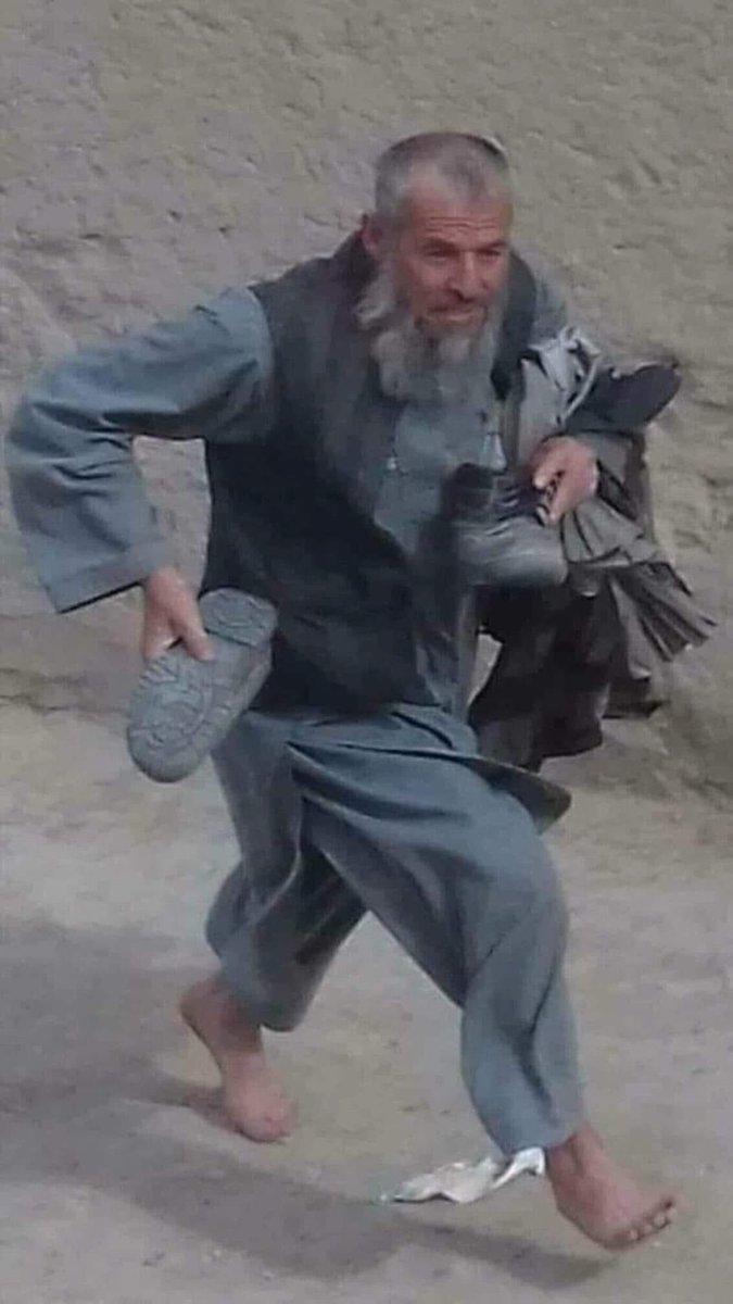 A man escapes the war in Farah province of #Afghanistan. He runs with all he has got in his lifetime, with all valuables: shoes and turban in hand. Can we still keep ourselves tight to not cry for this? Can we?