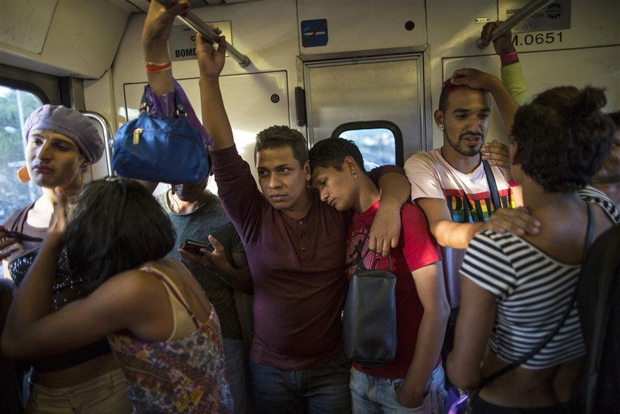 A group of transgender women and gay men ride a subway into Mexico City while traveling with the migrant caravan. Dozens of transgender women and gay men in the caravan have banded together for protection from their fellow travelers. nbcnews.to/2DIvKGd