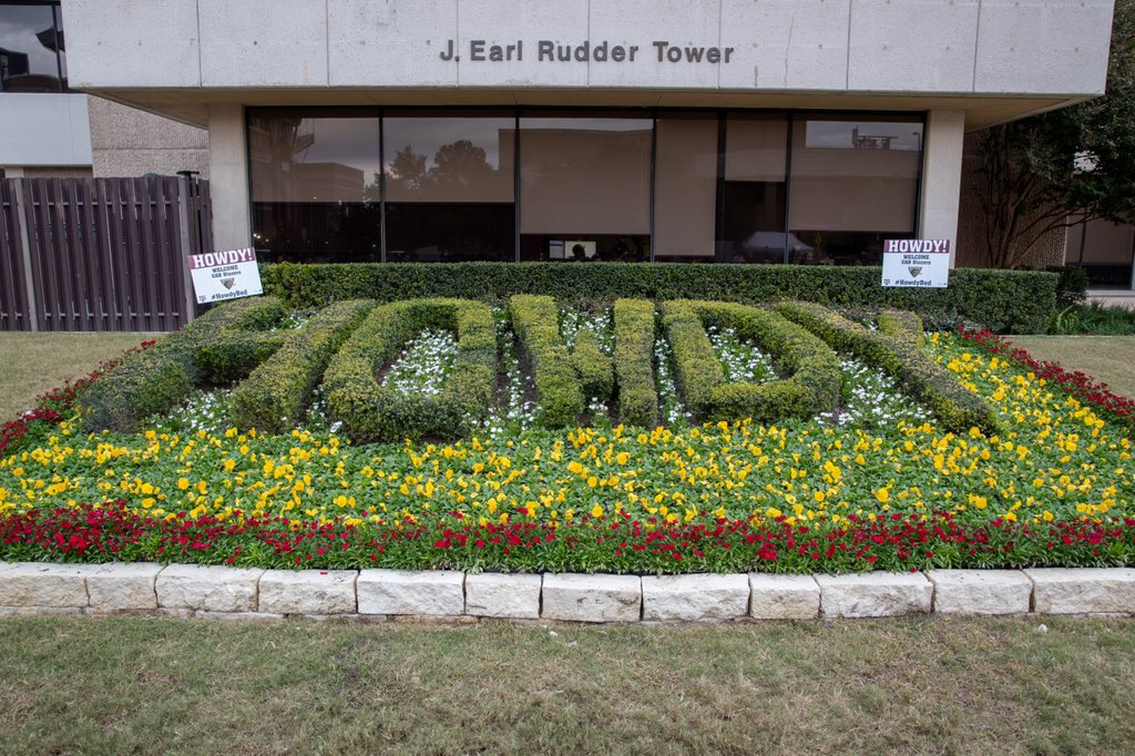 "Flower bed outside of Rudder Tower that says ""Howdy"""