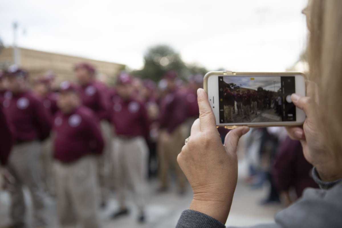 Woman taking photo of former cadets