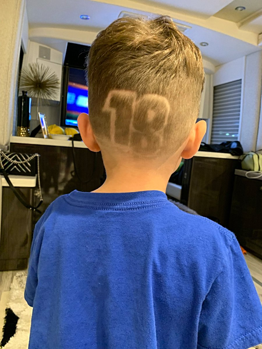 We went and got a little surprise for Daddy! Huge thank you to the barber for the patience with this bucking bronco. We r missing a part of the number but hey you get the idea 🏁🏆😊