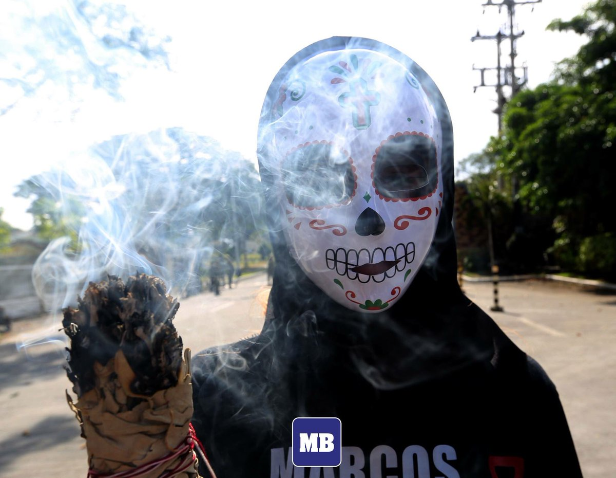 IN PHOTOS: Activists held a protest in front of the Libingan ng mga Bayani in Taguig during the 2nd year anniversary of former President Ferdinand Marcos' burial. (MB Photo by Ali Vicoy)