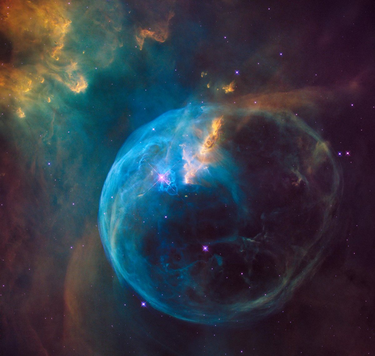 Do you see the star to the left of centre?  Gas on the star gets so hot that it escapes into space and sweeps up cold interstellar gas in front of it, creating the outer edge of the 'bubble'.   This is Bubble Nebula, or NGC 7635, courtesy of the Hubble Telescope.