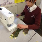 Image for the Tweet beginning: Textiles club making bookmarks for