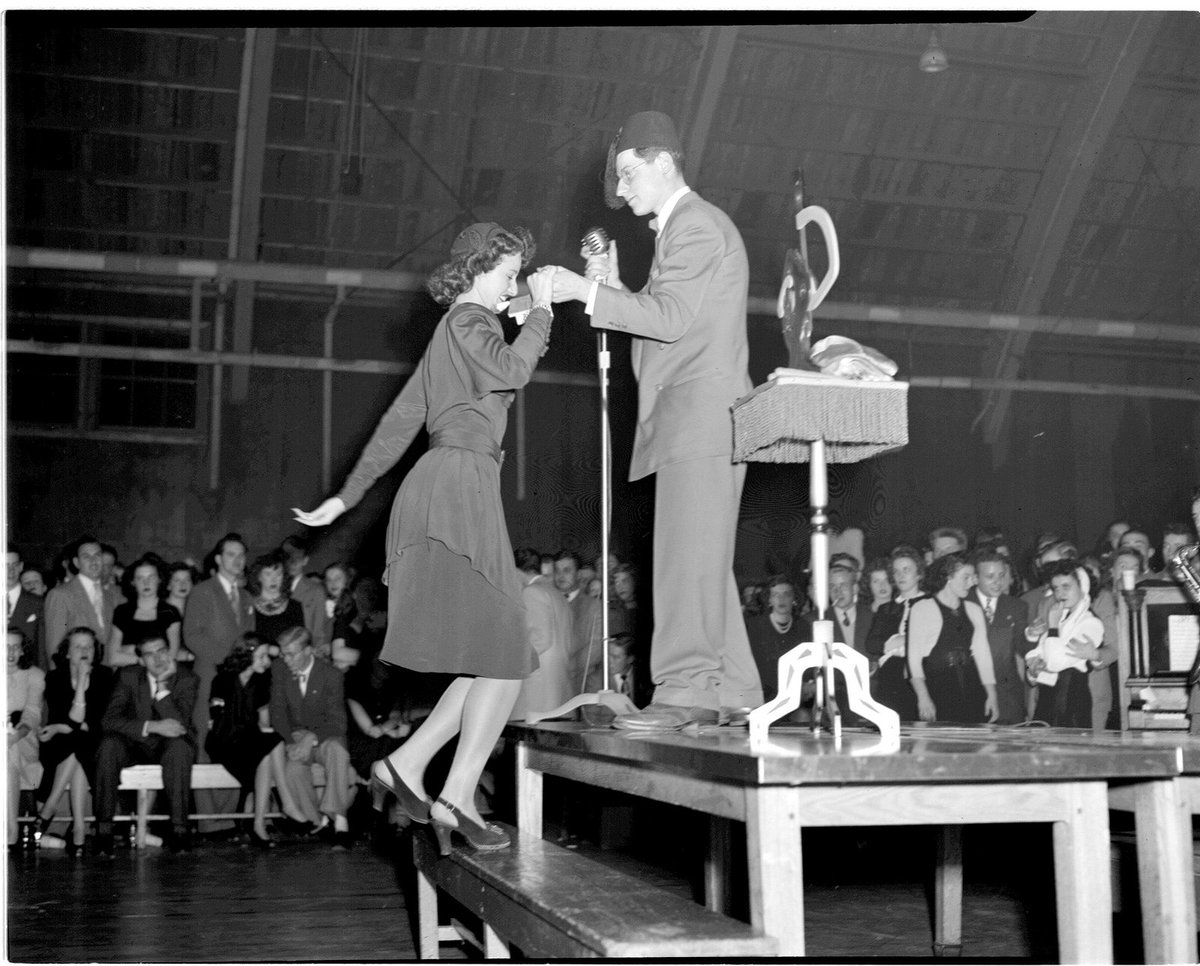 Happy Thanksgiving from the Chicago Art Deco Society! Enjoy the magic of the holiday, just like this magician helping a student volunteer up on stage for the 1946 Thanksgiving Dance at the Navy Pier Campus, UIC. (Photo via UIC Library Digital Collections Flickr) #vintagechicago