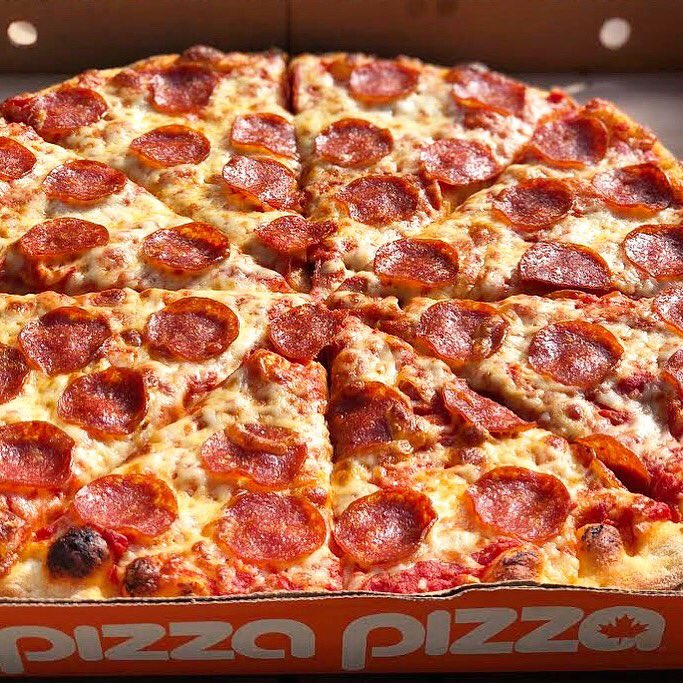 PIcture of a large pizza with pepperoni