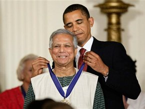 Formar president barack obama is Giving his honor to Dr. Yunus , a medal of honor.