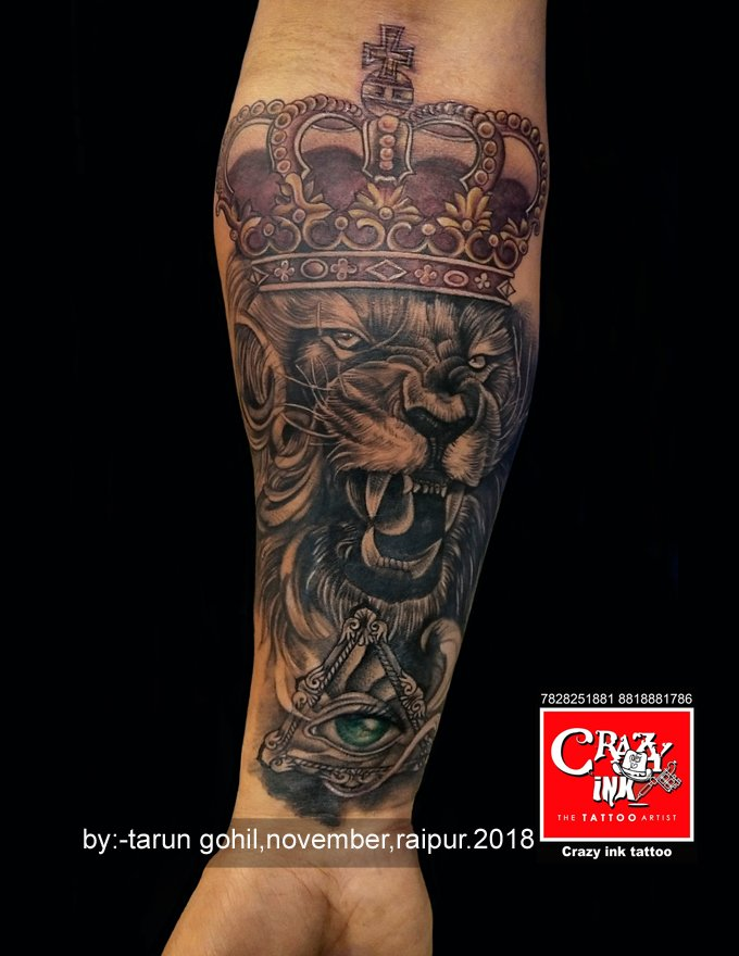 a9c8477c3 amazing and creative lion tattoo design with crown and god eye motive. by  tattoo artist 'Tarun gohil' (Raipur, India).
