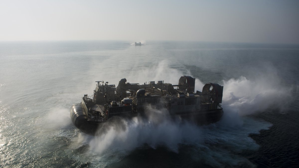 Landing Craft, Air Cushion 80, with Assault Craft Unit 5, Essex Amphibious Ready Group (ARG), departs from the Wasp-class amphibious assault ship USS Essex (LHD 2) Dec. 2, 2018