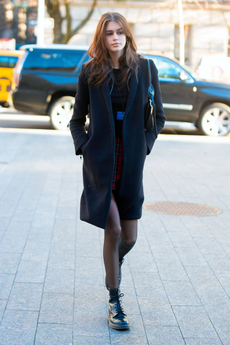 Kaia Gerber in a short plaid miniskirt with boots and sheer #pantyhose ... More here >>  http://ow.ly/IB4U30mTEIQ
