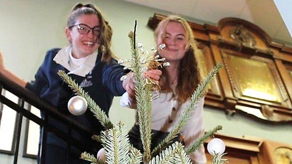 Sixth Form students putting the finishing touches to the school Christmas tree. @BeechenSixth