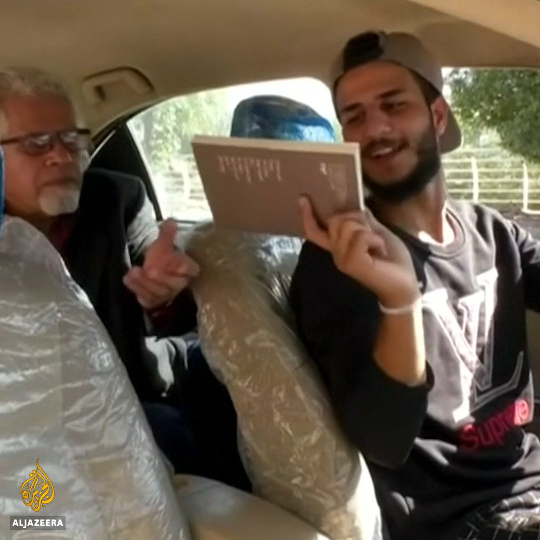 This Iraqi taxi driver asks passengers not to use their phones during rides - offering them a book to read instead.