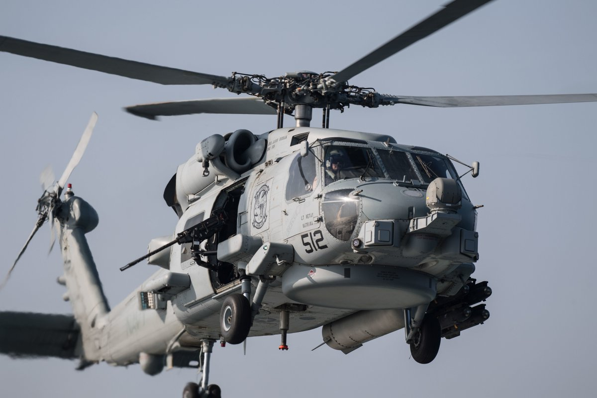 "An MH-60R Sea Hawk helicopter, assigned to the ""Vipers"" of Helicopter Maritime Strike Squadron (HSM) 48, conducts flight operations with the guided-missile destroyer USS Jason Dunham (DDG 109)"
