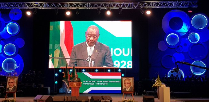 President Ramaphosa takes the podium to deliver his eulogy at the special official funeral service for Mr #MendiMsimang underway at Christian Revival Church Photo