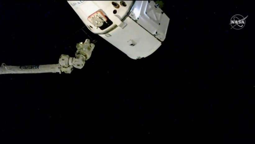 SpaceX Christmas delivery arrives at International Space Station 3 days after launch from Florida; it took 2 tries to get Dragon capsule close enough to be captured by Canadarm2 robotic arm (Image credit: NASA)