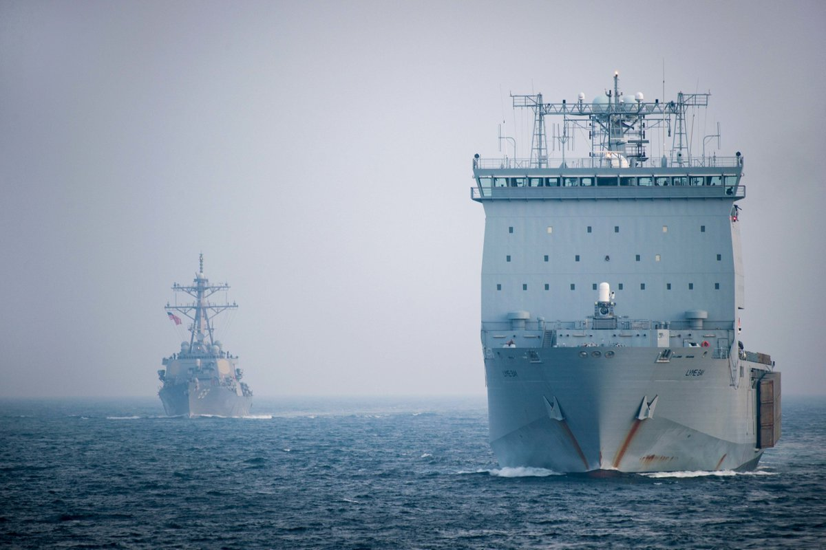 The Royal Navy's RFA Lyme Bay (L3007), right, is escorted by the Arleigh-Burke class guided-missile destroyers USS The Sullivans (DDG 68), left, and USS Jason Dunham (DDG 109) through the Bab al-Mandeb