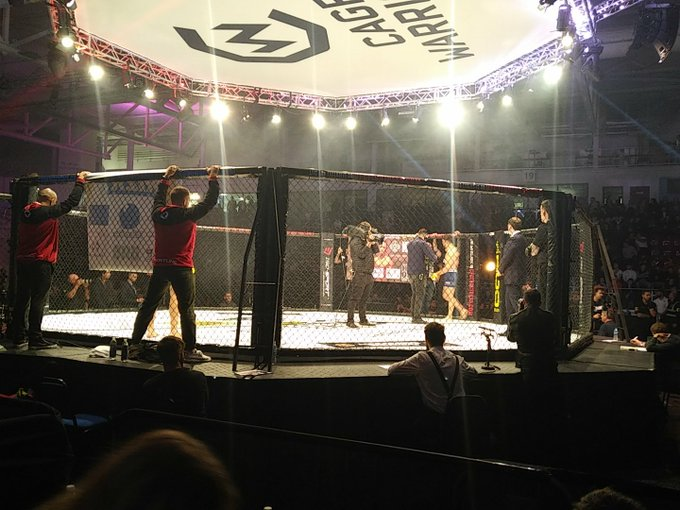 Cardiffian @KhalidMMA is taking to the cage at #CW100. Huge reception at the Ice Arena Wales in #Cardiff for the home favourite; for his contest v. Håkon Foss at welterweight. Fantastic contrast of @CageWarriors styles ahead. Photo